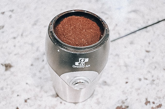 freshly ground coffee in electric grinder